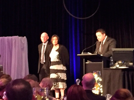 CrestClean Nelson was a finalist in the 2015 Westpac Nelson Tasman Chamber of Commerce Business Awards. Pictured on stage with MC Duncan Garner is Regional Manager Barbara de Vries and husband, Shane.