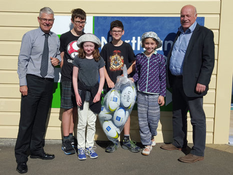 Northland School principal Jeremy Edwards was pleased he won a set of rugby balls. He is pictured with Wellington Regional Manager Richard Brodie.