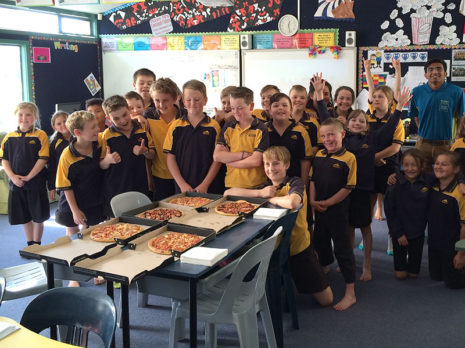 Bluestone School's Room 16 enjoyed a pizza lunch for winning the Cleanest Classroom competition. Pupils are pictured with franchisee Harsh Patel.