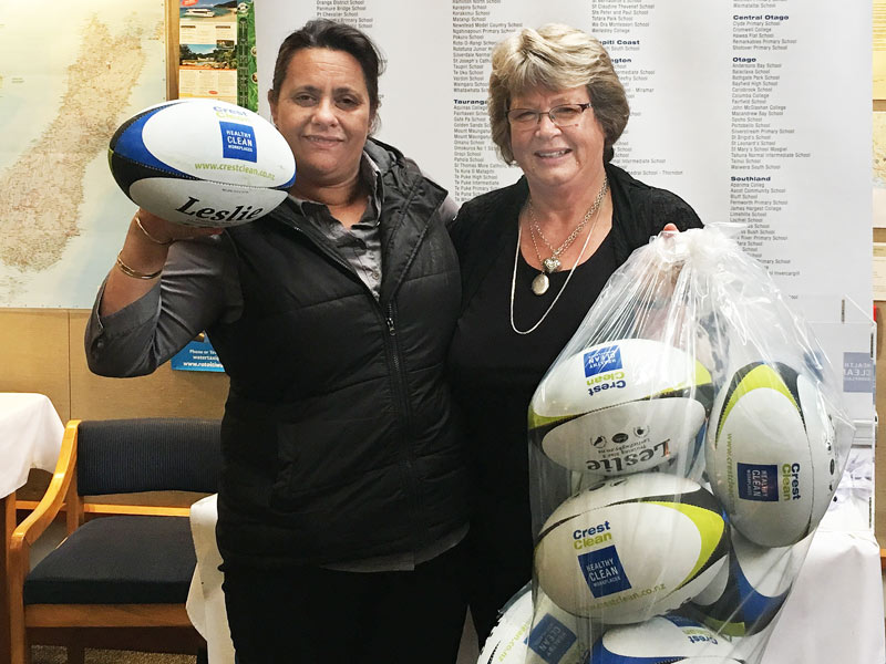 Barbara de Vries (right), Crest's Nelson Regional Manager, presents rugby balls to Janice Gulbransen, Principal of Nayland Primary School, Nelson.