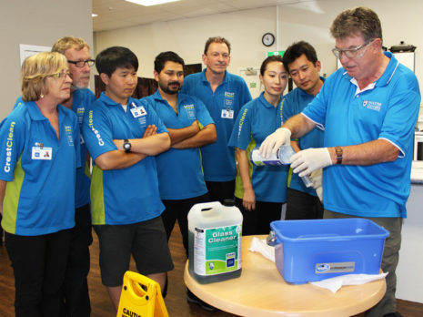 Adam Hodge shows franchisees how to safely pour cleaning solutions to obtain the correct dilution.