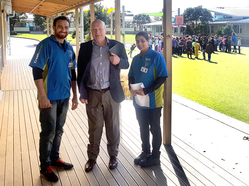 Sharnjit Singh and Mandeep Kaur with CrestClean's Wellington Regional Manager Richard Brodie at Lyall Bay School.
