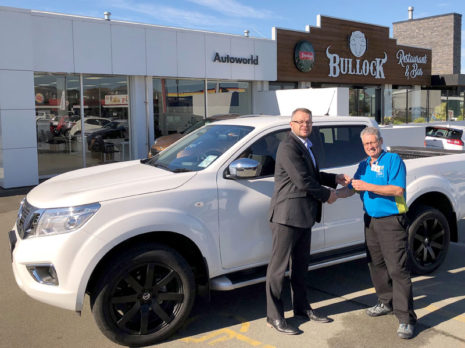Chris Churchward, General Manager Autoworld Timaru, with Murray Kelly and his new Nissan Navara.