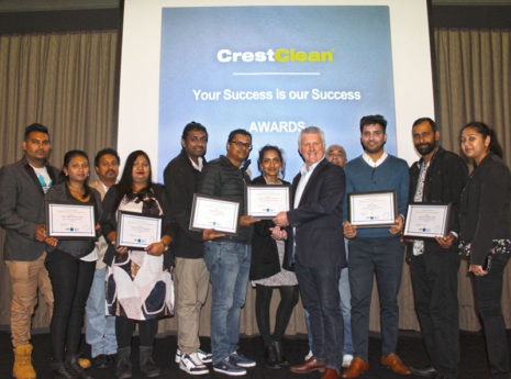 Three-year long service recipients receive their certificates from Grant McLauchlan, CrestClean's managing director the Auckland Team Meeting.