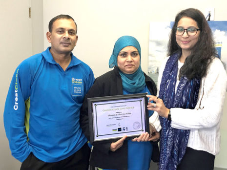 Shamim and Sharina Khan receive their long service award from Shareen Raj, CrestClean's Palmerston North / Kapiti Coast Regional Manager.