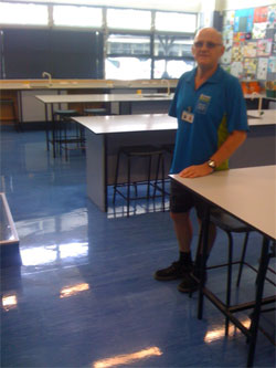 Athol Vogt with his lovely polished floors at Kingsway School