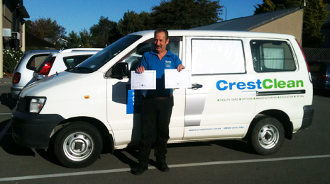 Pictured is Colin Hunt standing with his van holding two of his four Certificates of Excellence's