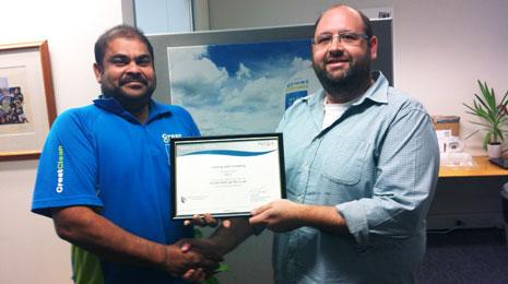 Pictured is Wellington Regional Director Andrew Alleway congratulating Ram on his achievement