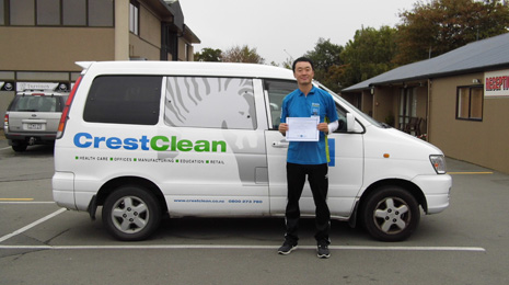 Jason Kang proudly shows off his Certificate recognising 5 years as a CrestClean business owner.