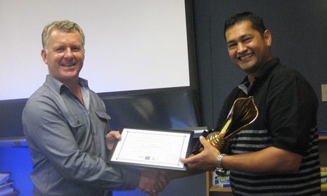 CrestClean Managing Director Grant McLauchlan giving Michael one of his three awards