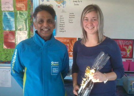 Pictured is Invercargill Franchisee Siva Krishnan with Room 5 Teacher Nicole McMath who received a bottle of wine for her part in having the cleanest classroom in the School.
