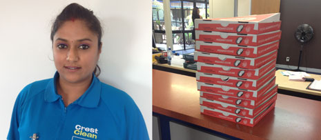 Pictured Left is Franchisee Sharon Singh and Right, the stack of Pizza ready to be devoured