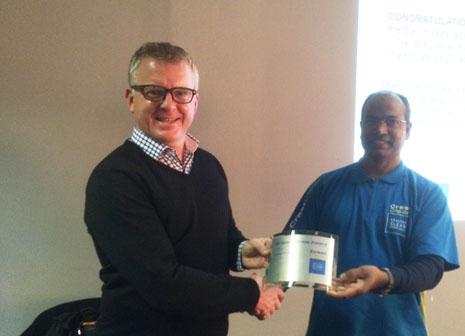 Dorsamy Goundar receiving his 10 Years Long Service Award from Grant McLauchlan, CrestClean's Managing Director.