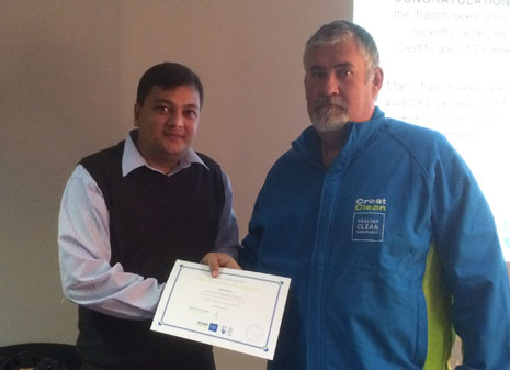 Nivitesh Kumar awarding a Certificate of Excellence to Louis Meyer for his outstanding customer service at Livestock Improvement Corporation.