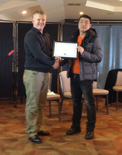 Grant McLauchlan awards Michael Choi for 5 years with CrestClean.
