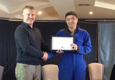 Tianlei Fu receiving his 5 Years Long Service Award from Grant McLauchlan.