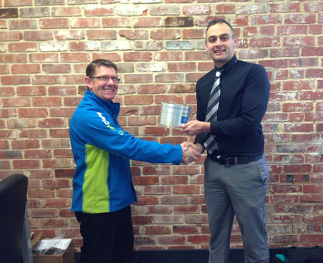 Vincent Fisk receiving his 10 Year Long Service Award from Otago Regional Director Tony Kramers.