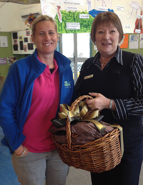 Melissa Palmer and Jackie Matthews accepting a gift basket of goodies, presented to CrestClean's 3000th customer, ABC Blenheim Central Daycare.