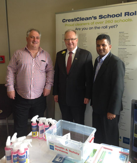Auckland Central Regional Director Dries Mangnus, NZPF President Phil Harding, and Viky Narayan, Regional Director for South and East Auckland, in front of CrestClean's School Roll banner.