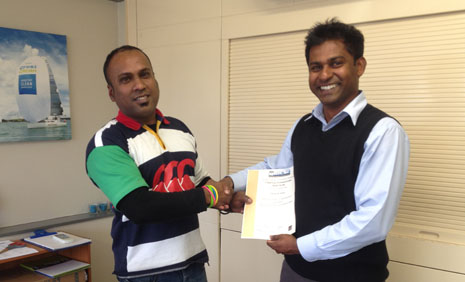 Ronesh Nand accepting his Cleaning Professional Skills Suite Certificate from Regional Director Yasa Panagoda.