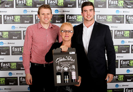 Sam Lewis, Wendy Carey, and Nick Dunne from CrestClean's Dunedin office, accepting the Deloitte Fast 50 'Sustained Growth Award' in the Otago and Lower South Island region.