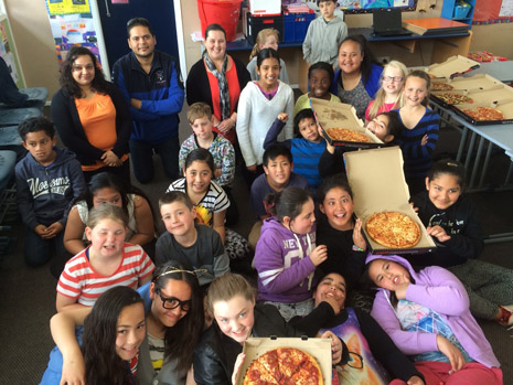 The cleanest kids at St Claudine School with their pizza lunch prize from CrestClean.
