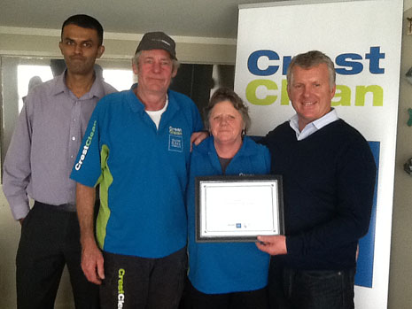 North Harbour Regional Director Neil Kumar (left) and CrestClean's Managing Director Grant McLauchlan (right), congratulating Michael and Jean Dellow for their 7 Years Long Service.