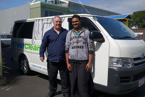 Auckland franchisee Prateesh showing off his newly signwritten Toyota Hiace with Regional Director Dries Mangnus.