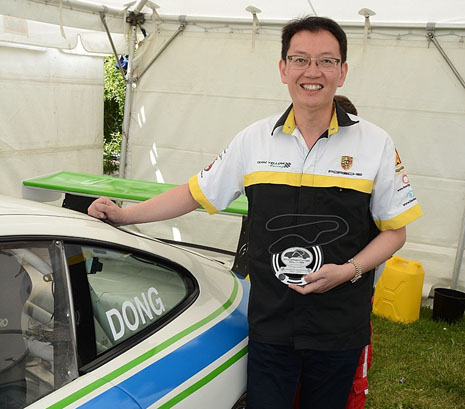 Robert Dong, new owner of the CrestClean-branded Porsche, with his Driver of the Weekend trophy at Manfeild.