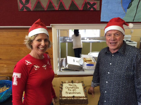 Regional Directors Clare Menzies and Richard Brodie celebrate in holiday finery.