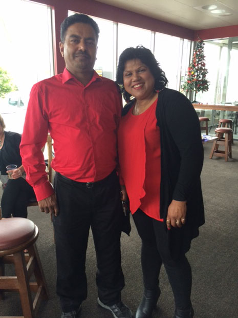 Birendra and Lakshmi Kumar looking festive in matching red shirts.