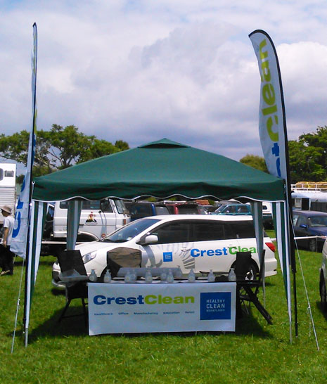 CrestClean's information table at the Opotiki Rodeo was decorated with bright, visible flags and banners.
