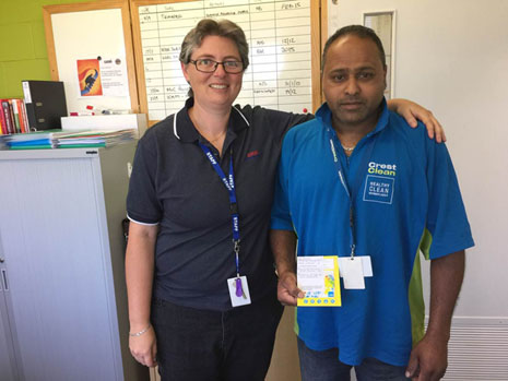 Wiri Oil HSSE Assurance Manager Natalee Scripps with CrestClean franchisee Dinesh Prasad and his award for excellent service.