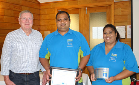 Davendran and Prithi Nairl receiving congratulations on 10 years with CrestClean from Marty Perkinson, Chairman of Directors.