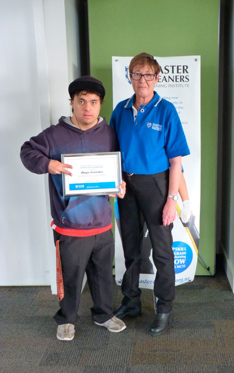 Diego Gonzalez, of MacLaren Park Henderson South Community Trust, received a certificate of completion from the Master Cleaners Training Institute. Diego is pictured with Auckland Operations Coordinator Julie Griffin.