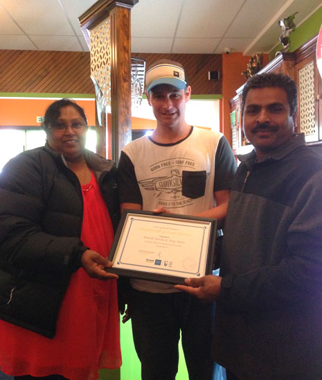 Franchisees Nag Mani, Binesh Naidu were presented with their three-year long service award by Tauranga Regional Manager Jan Lichtwark.