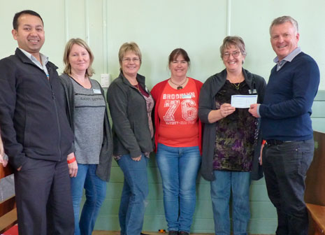CrestClean Taranaki Regional Manager Prasun Acharya and Managing Director Grant McLauchlan presented a $500 cheque to Waitara Central Kindergarten staff.