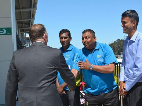 Naresh Mani, left, Rameshwar Sharma and Neil Kumar enjoying meeting Rt Hon John Key.