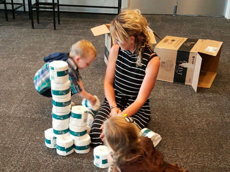 Children decided to make their own tower out of toilet paper with guidance from Sarah.