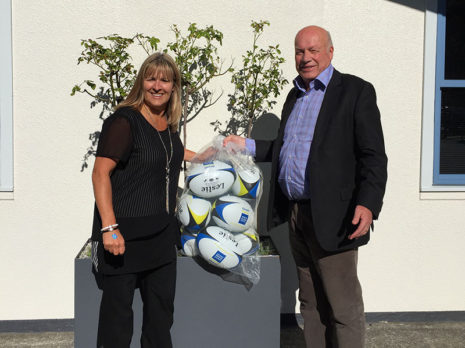 Richard presented a set of rugby balls to Discovery School principal Carmen Jennings.