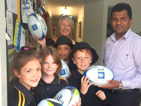 Auckland South Regional Manager Viky Narayan donated five rugby balls to Mauku School for their annual Fun Run fundraising event. Viky is pictured with principal Angela Smith.