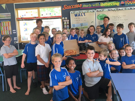 Kotuku classroom pupils at Saint Paul's Catholic School in Richmond were pleased with their pizza lunch prize after they won the Cleanest Classroom Award for Term 1. They are pictured with Nelson franchisees Melanie and Robyn Fern.