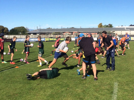 Junior rugby players enjoyed practicing skills and drills with John Leslie.