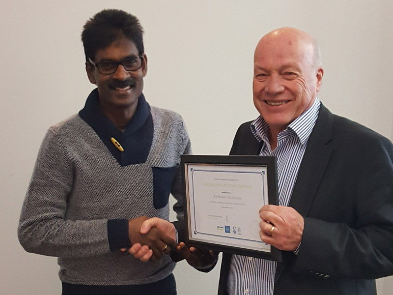 Keshwan receives his seven-year Long Service Certificate from Wellington Regional Manager Richard Brodie.