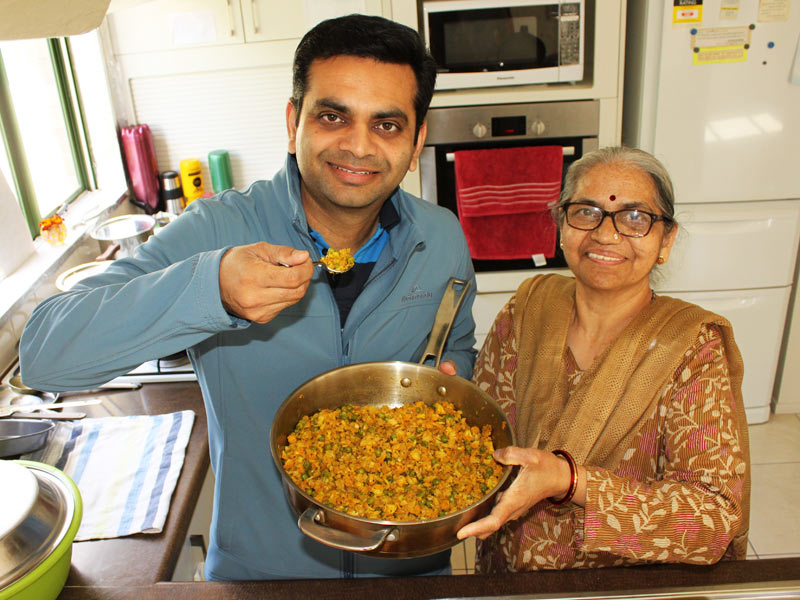 Pinakin Patel helping his mum Niruben in the kitchen.