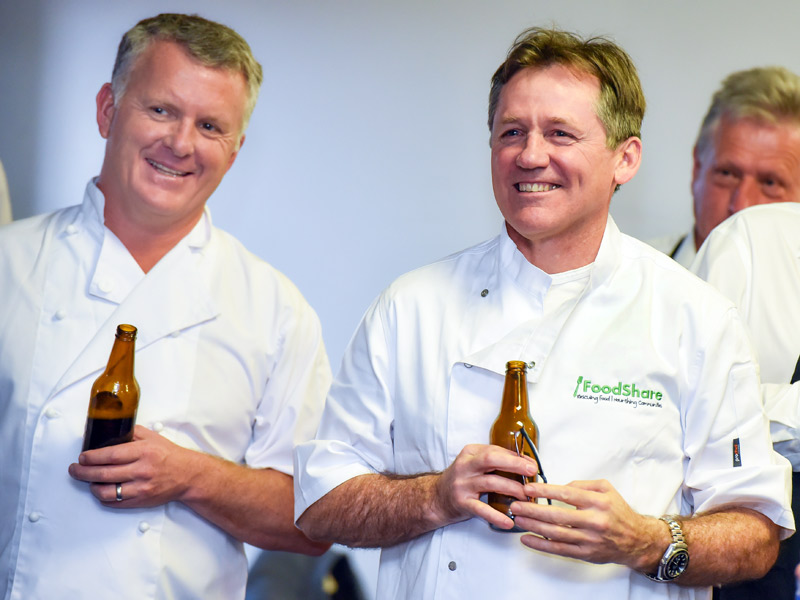 Time for a well-earned cold one as Grant McLauchlan and David Kirk relax after the cooking contest.