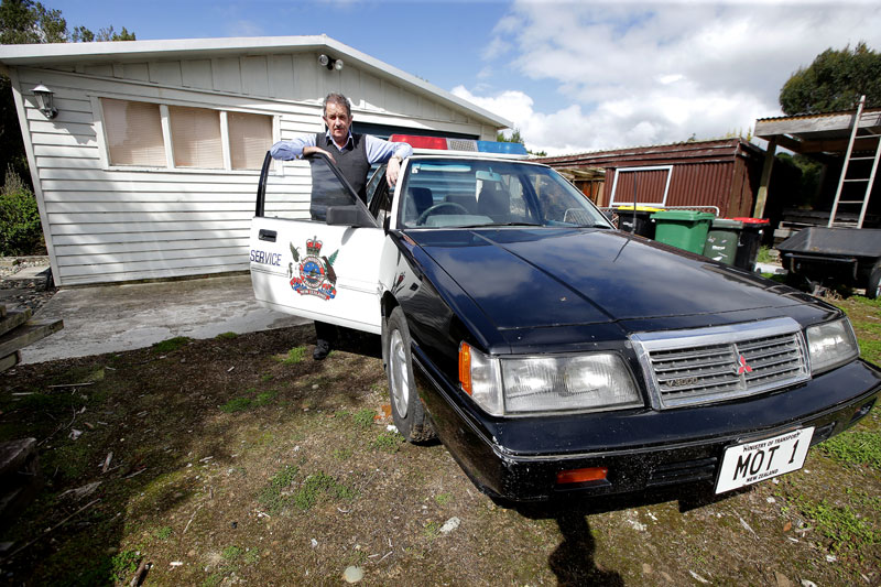 Glenn Cockroft with his 1991 Mitsubishi V3000 patrol car. Photo: ROBYN EDIE/STUFF