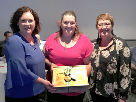 Susan Impey, Opotiki College Principal, receives her gift box prize from CrestClean's Caroline Wedding and Rachael Hanna.