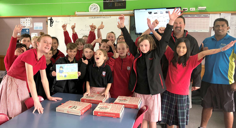 Everyone was happy when CrestClean business owner Krishna Kumar turned up with pizza for the winning class at Ashburton Borough School.