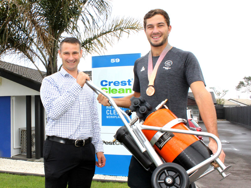 CrestClean Tauranga Regional Manager Jan Lichtwark presents a Pure Water Window Cleaning kit to Ben O'Dea.